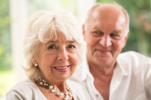 attractive senior woman and her loving husband
